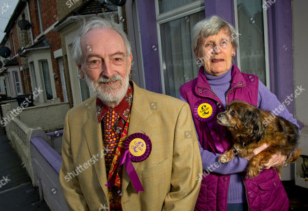 Stock Picture of Martin Costello, Aubrey & Sheila Attwater in front of their purple painted house .