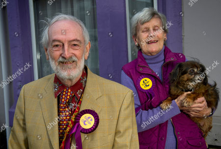 Martin Costello, Aubrey & Sheila Attwater in front of their purple painted house.