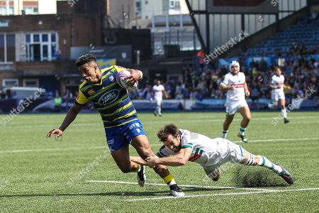 Rey Lee-Lo of Cardiff Blues gets away from Conrad Smith of Pau