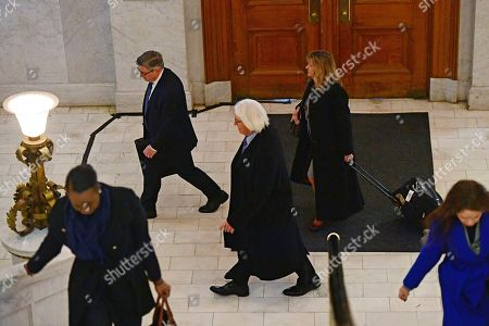 Tom Mesereau, center, lawyer for actor and comedian Bill Cosby, arrives for the Bill Cosby arrives sexual assault trial at the Montgomery County Courthouse, in Norristown, Pa