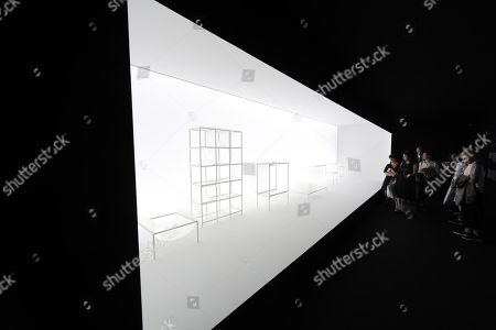 Stock Picture of Visitors watch the installation of the Nendo studios by designer Oki Sato at the Fuori Salone Design Week in Milan, Italy, 18 April 2018. The fair runs from 17 to 22 April and presents the latest trends and designs on furniture, lighting and home accessories.