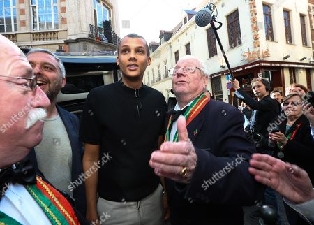 Editorial picture of Stromae visits statue of Manneken Pis, Brussels, Belgium - 17 Apr 2018