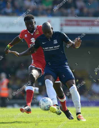 Marc-Antoine Fortune of Southend United shielding the ball from Ousseynou Cisse of Milton Keynes Dons