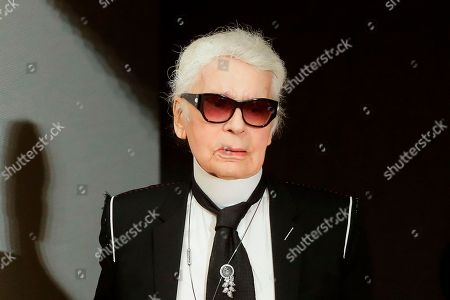 """Fashion designer Karl Lagerfeld walks over the stage at Chanel's pre-fall Metiers d'Art fashion show in the new Elbphilharmonie concert house in Hamburg, northern Germany. The oft-outspoken designer drew the ire of the Model Alliance, over published remarks on a French fashion site referring to models as """"stupid,"""" """"toxic"""" and """"sordid creatures."""" Sara Ziff, founder of the New York-based organization to protect the rights of models, said the recent comments published by Numero.com were not surprising coming from Lagerfeld but the sentiment, thanks to the #MeToo and Time's Up movements, """"carry the day no longer"""