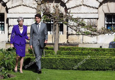 Theresa May and Justin Pierre James Trudeau