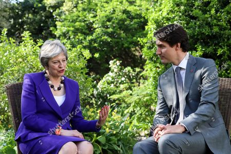 Stock Picture of Theresa May and Justin Pierre James Trudeau