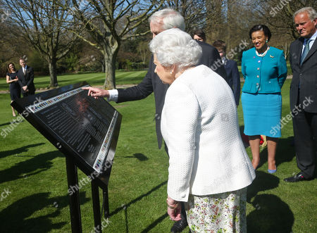 Queen Elizabeth II and Hugo Vickers during the unveiling of a panel marking the walkway in Buckingham Palace gardens, London, in relation to the Commonwealth Walkway project.
