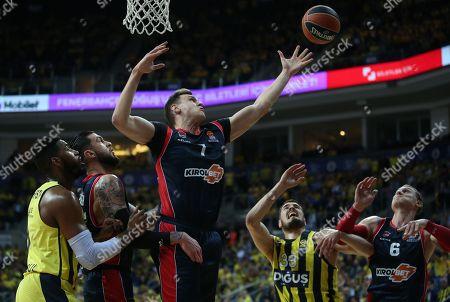 Stock Image of Nikola Kalinic (2-R) and Jason Thompson (L) of Fenerbahce in action against Johannes Voigtmann (C) of Baskonia during the Euroleague basketball match between Fenerbahce Dogus and Baskonia Vitoria Gasteiz, in Istanbul, Turkey, 18 April 2018.