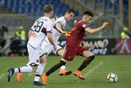 Roma's Stephan El Shaarawy (R) vies for the ball with Genoa's players, Aleandro Rosi (C) and Oscar Hiljemark (L), during the Italian Serie A soccer match AS Roma vs Genoa at Olimpico Stadium in Rome, Italy, 18 April 2018.