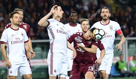 Torino's Nicolas Burdisso (2-R) and  Milan's Nikola Kalanic (3-L) in action during the Italian Serie A soccer match Torino FC vs AC Milan at Olimpico Stadium in Turin, Italy, 18 April 2018.