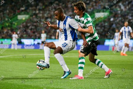 Sporting CP player Fabio Coentrao (R) vies for the ball with FC Porto player Ricardo Pereira during the Portugal Cup semi-final second leg match against FC Porto held at Alvalade Stadium in Lisbon, Portugal, 18 April 2018.