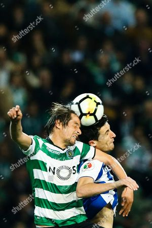 Sporting player Fabio Coentrao (L) in action against Ivan Marcano of FC Porto during their Portugal Cup semi-final  second hand soccer  match held at Alvalade stadium in Lisbon, Portugal,18 April 2018.