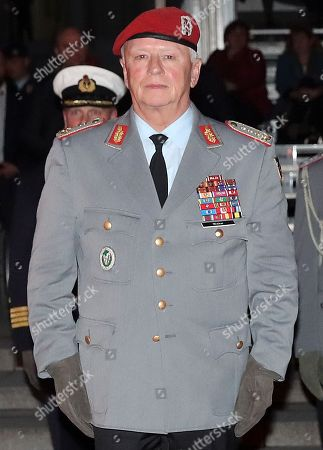 The Chief of Staff of the Bundeswehr, General Volker Wieker, attends a Grand Tattoo military ceremony at the Ministry of Defence, in Berlin, Germany, 18 April 2018. General Wieker is being awarded the honor of a Grand Tattoo after 44 years of service in the German armed forces, eight of them as Chief of Staff. The Grand Tattoo is the highest military ceremony the German armed forces (Bundeswehr) award and is executed in the evening with a military formation carrying torches and a band playing various marches.