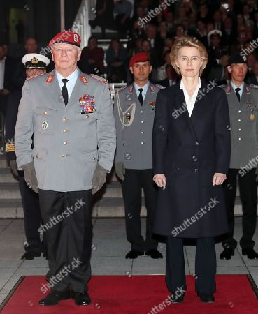 Defense Minister Ursula von der Leyen (R) and Chief of Staff of the Bundeswehr, General Volker Wieker (L) attend a Grand Tattoo military ceremony at the Ministry of Defence, in Berlin, Germany, 18 April 2018. General Wieker is being awarded the honor of a Grand Tattoo after 44 years of service in the German armed forces, eight of them as Chief of Staff. The Grand Tattoo is the highest military ceremony the German armed forces (Bundeswehr) award and is executed in the evening with a military formation carrying torches and a band playing various marches.