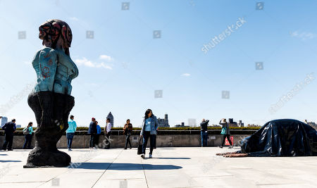 People look over artist Huma Bhabha?s sculptural installation ?We Come in Peace? which  was commissioned for the Iris and B. Gerald Cantor Roof Garden at the Metropolitan Museum of Art in New York, New York, USA, 18 April 2018. The title of the piece which is on on view until 28 October 2018, comes from the 1951 film ?The Day the Earth Stood Still?.
