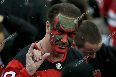 "Patrick Warburton, the actor who played David Puddy on ""Seinfeld"" and wore makeup supporting the New Jersey Devils during an episode of the show, gestures at the end of Game 4 of an NHL first-round hockey playoff series between the Devils and the Tampa Bay Lightning, in Newark, N.J. The Lightning won 3-1"