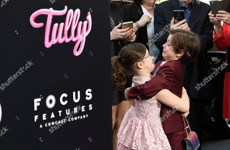 """Lia Frankland, Asher Miles Fallica. Lia Frankland, left, and Asher Miles Fallica, cast members in the film """"Tully,"""" hug as they arrive movie's Los Angeles premiere at Regal Cinemas L.A. Live on"""