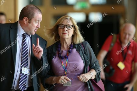 Scottish Parliament First Minister's Questions - Graeme Day and Linda Fabiani, Deputy Presiding Office of The Scottish Parliament make their way to the Debating Chamber.