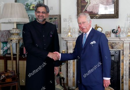 Britain's Prince Charles, right, greets the Prime Minister of Pakistan Shahid Khaqan Abbasi at Clarence House in London, . Shahid Khaqan Abbasi is in London to take part in the Commonwealth Heads of Government Meeting