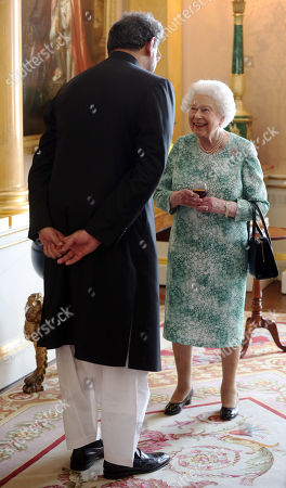 Queen Elizabeth II receives the Prime Minister of Pakistan Shahid Khaqan Abbasi during a lunchtime reception for new Commonwealth Heads of Government at Buckingham Palace