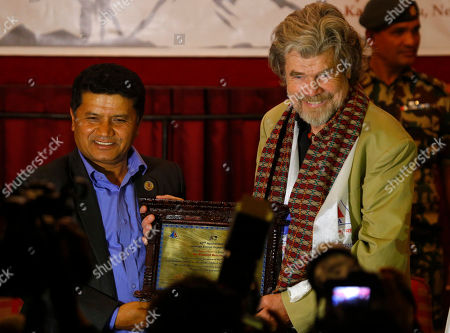 Italian mountaineer Reinhold Messner is felicitated by Nepal's government in Kathmandu, Nepal, . Nepal's government on Thursday honored two climbers who were the first to scale Mount Everest without supplementary oxygen 40 years ago. Messner and Austrian Peter Habeler reached the summit without use of supplementary oxygen, while others on their team used bottled oxygen