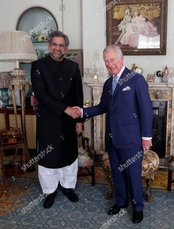 Britain's Prince Charles, right, greets the Prime Minister of Pakistan Shahid Khaqan Abbasi at Clarence House in London, Thursday, April 19, 2018. Shahid Khaqan Abbasi is in London to take part in the Commonwealth Heads of Government Meeting