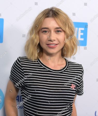 Olesya Rulin arrives at WE Day California at The Forum, in Inglewood, Calif