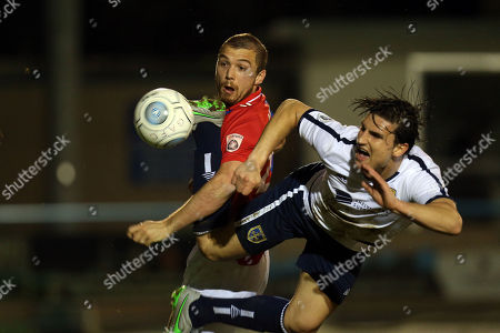 Michael Cheek of Dagenham and Redbridge beats Sean St Ledger of Guiseley to score the fifth goal during Guiseley vs Dagenham & Redbridge, Vanarama National League Football at Nethermoor Park on 19th April 2018