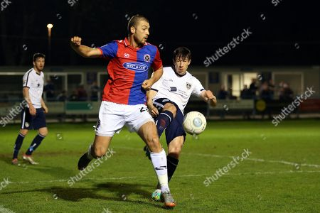 Stock Photo of Sean St Ledger of Guiseley and Michael Cheek of Dagenham and Redbridge during Guiseley vs Dagenham & Redbridge, Vanarama National League Football at Nethermoor Park on 19th April 2018