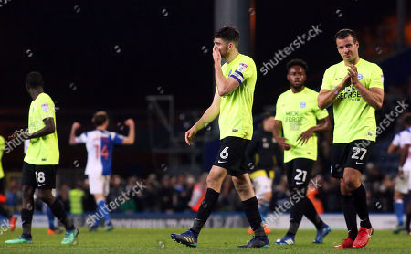 Jack Baldwin and Steven Taylor of Peterborough United leave the pitch dejected at full-time