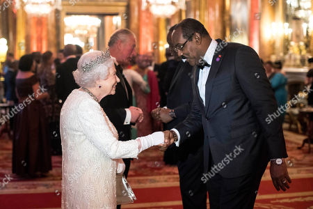 Queen Elizabeth II greets Gaston Browne, Prime Minister of Antigua and Barbuda, in the Blue Drawing Room at Buckingham Palace in London as she hosts a dinner during the Commonwealth Heads of Government Meeting.