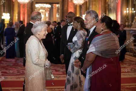 Queen Elizabeth II greets Enele Sopoaga, Prime Minister of Tuvalu, in the Blue Drawing Room at Buckingham Palace in London as she hosts a dinner during the Commonwealth Heads of Government Meeting.