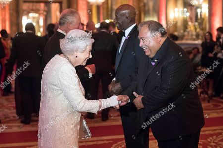 Queen Elizabeth II greets Baron Waqa, President of Nauru, in the Blue Drawing Room at Buckingham Palace in London as she hosts a dinner during the Commonwealth Heads of Government Meeting.