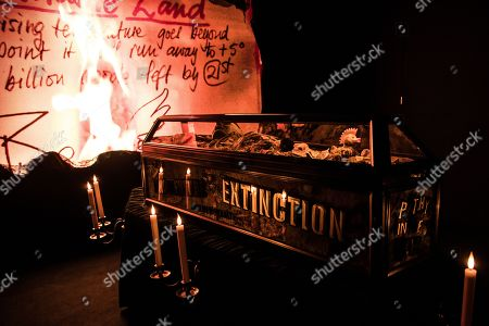 Stock Picture of The ashy remains of £5m of torched punk memorabilia are displayed in a coffin along with Malcolm McLaren death mask