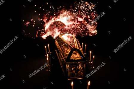 Stock Photo of The ashy remains of £5m of torched punk memorabilia are displayed in a coffin along with Malcolm McLaren death mask