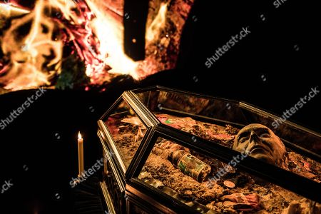 Stock Image of The ashy remains of £5m of torched punk memorabilia are displayed in a coffin along with Malcolm McLaren death mask