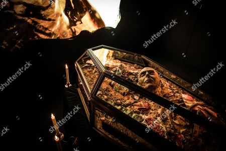 The ashy remains of £5m of torched punk memorabilia are displayed in a coffin along with Malcolm McLaren death mask