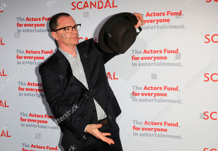 """Joshua Malina, cast member of """"Scandal"""" plays with his hat at the live stage reading of the series finale at El Capitan Theatre, in Los Angeles"""