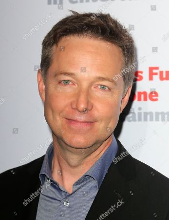 """Stock Image of George Newbern, cast member of """"Scandal"""" arrives at the live stage reading of the series finale at El Capitan Theatre, in Los Angeles"""