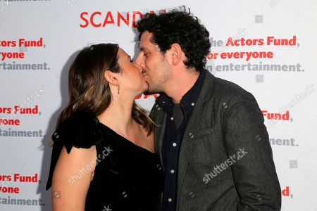 """Katie Lowes, Adam Shapiro. Katie Lowes, left, and Adam Shapiro kiss at the live stage reading of the """"Scandal"""" series finale at El Capitan Theatre, in Los Angeles"""