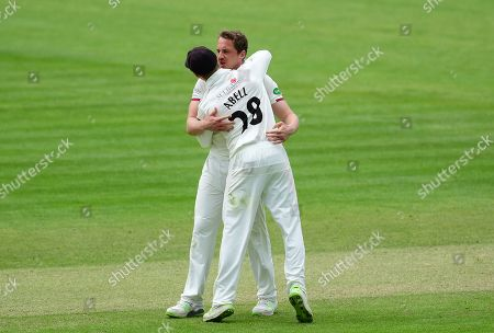 Josh Davey of Somerset celebrates the wicket of Ben Cox  with Tom Abell, captain of Somerset