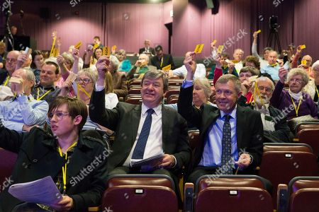 Stock Image of Alistair Carmichael MP and Willie Rennie MSP, Leader of the Scottish Liberal Democrats, vote at the end of a debate on Police Reform