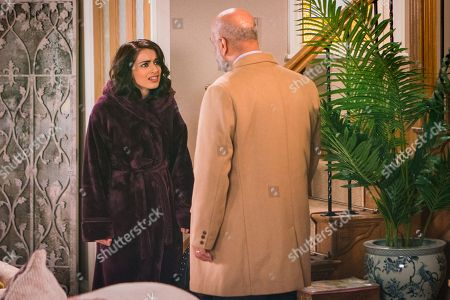 Stock Image of Ep 9441 Friday 27th April 2018 - 1st Ep Rana Nazir, as played by Bhavna Limbachia, receives an anonymous phone call and is shocked when her father Hassan Habeeb, as played by Kriss Dosanjh, arrives at number 6 an angrily accuses her of having her mother arrested.