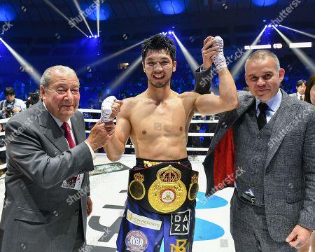 Ryota Murata of Japan celebrates with boxing promoter Bob Arum and WBA president Gilberto Mendoza Jr. after winning the WBA middleweight title bout