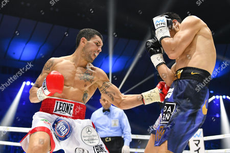 Emanuele Felice Blandamura of Italy hits Ryota Murata of Japan in the third round during the WBA middleweight title bout