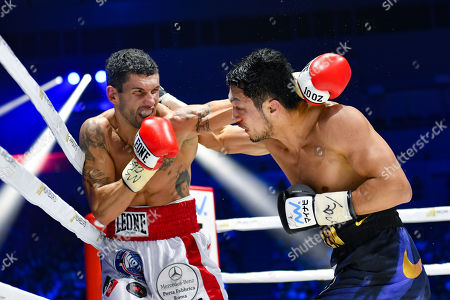 Ryota Murata of Japan and Emanuele Felice Blandamura of Italy in action during the seventh round of the WBA middleweight title bout