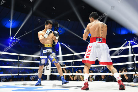 Ryota Murata of Japan and Emanuele Felice Blandamura of Italy during the first round of the WBA middleweight title bout