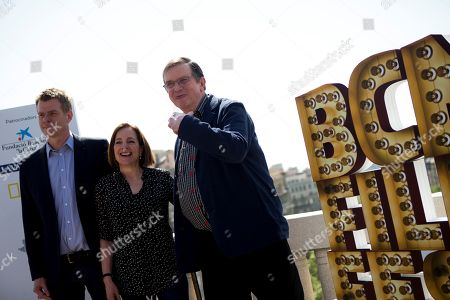 British filmmaker Mike Newell (R) poses for the media next to producers Paula Mazur (C) and Graham Broadbent, prior to the presentation of his latest film, 'The Guernsey Literary and Potato Peel Pie Society', during opening of the BCN Film Fest in Barcelona, northeastern Spain, 20 April 2018. The festival runs from 20 until 27 April 2018.