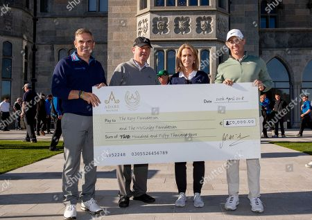 Paul McGinley and Rory McIlory pictured receiving a cheque for ?250,000 from sponsor, JP McManus and Sue Ann Foley after the game finished level at The Golf Course at Adare Manor after the 2020 Pro-Am was launched. The monies will be donated to xx charity TBC