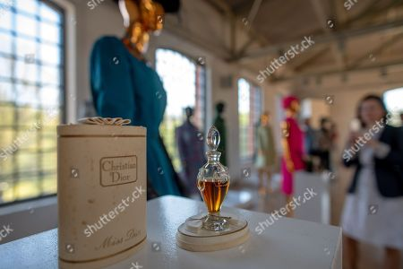 A Christian Dior 'Miss Dior' perfume bottle on display during the presentation of an exhibiton, titled 'Christian Dior and the Parisian fashion icons from the collection of Adam Lej' at the Central Museum of Textiles in Lodz, Poland, 20 April 2018. The show freatures more than 300 exhibits, including first creations, jewelry, shoes, hats by Dior, Coco Chanel, Yves Saint Laurent, Givenchy, from the collection of Polish costume designer Adam Lej.